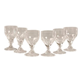 A set of six crystal glasses each with a series of facets on the exterior of the bowl from Belle Epoque period France c.1890