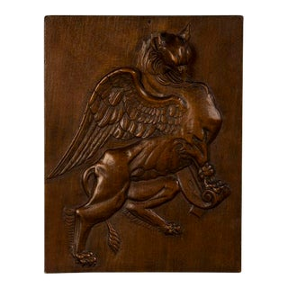 A handsome carved wall hanging of a winged griffin from France c. 1860