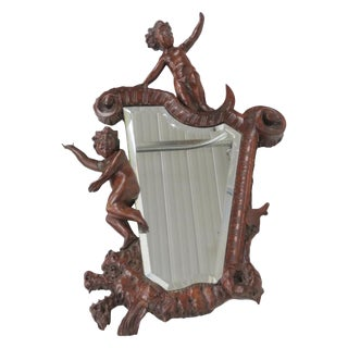 19th C. Carved Mahogany Mirror with Puttis