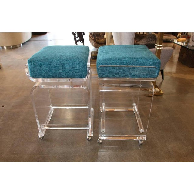 Image of Pair of Lucite Bar Stools on Swivel Tops and Castors