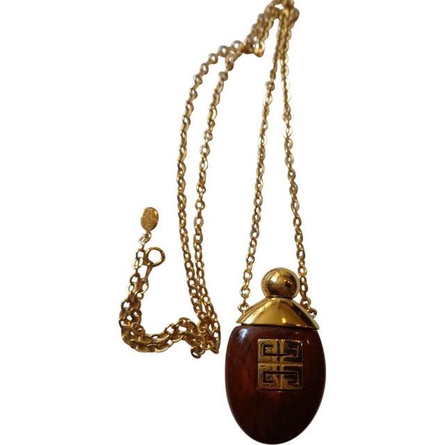 Image of Givenchy Bakelite Perfume Bottle Necklace