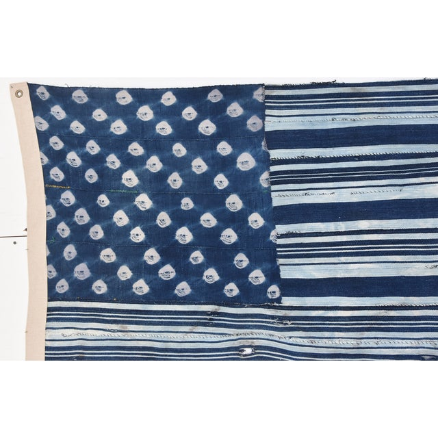 Image of Custom Tailored Blue & White Flag Created From Vintage African Fabrics
