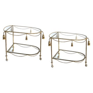 A chic pair of Italian mid-century Hollywood regency gilt-tole drinks-bar carts with glass shelves