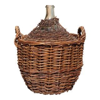 Monumental French Clear Glass Demijohn Bottle in Woven Grape Vine Basket.