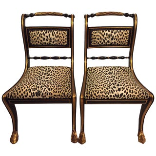 Two of a Set of 12 Ebonized and Gilt Gold Side Chairs
