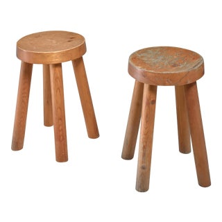 Charlotte Perriand pair of four legged pine stools, France, 1960s