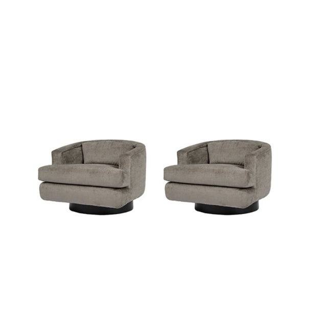 Image of Pair of Swivel Lounge Chairs by Milo Baughman