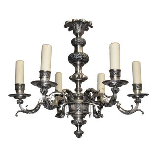 Antique chandelier, silver over bronze