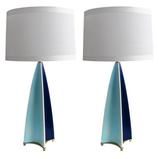 A stylish and rare pair of Gerald Thurston for Lightolier parabolic fin lamps