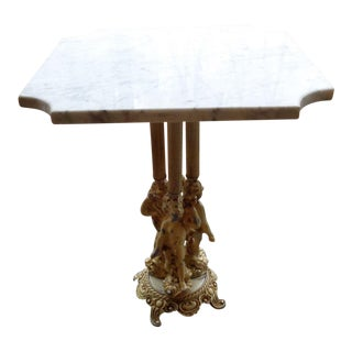 Antique Table With Marble Table Top and Ornate Figure Legs