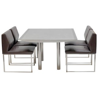 Stainless Steel Table with Four Leather and Steel Chairs