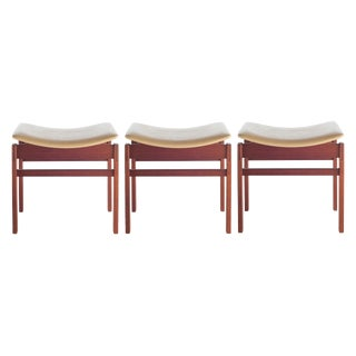 SET OF THREE WALNUT AND LEATHER STOOLS BY JENS RISOM, CIRCA 1950S