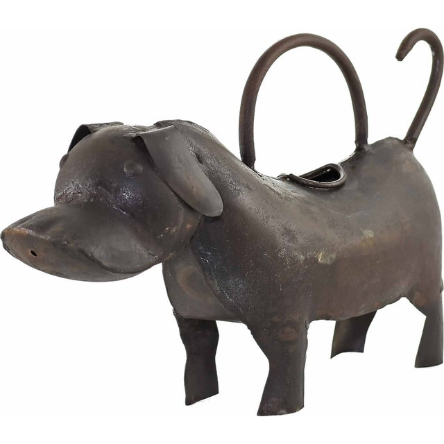 Image of Dog Iron Watering Can