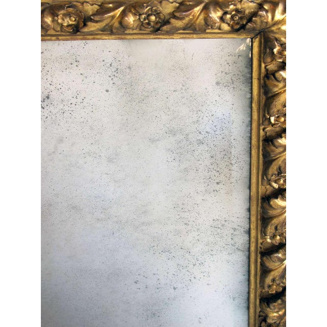 Image of A Richly Carved Italian Baroque Style Giltwood Mirror with Reticulated Frame