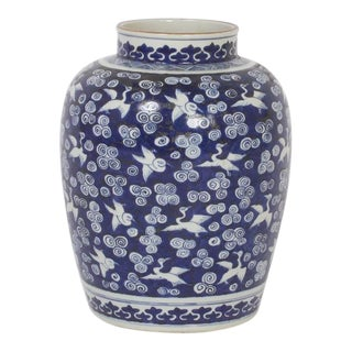 Pair of Chinese Export Style Blue and White Jars with a Bird Motif