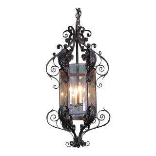 Tall Early 20th Century French Black Four-Light Iron Lantern With Beveled Glass