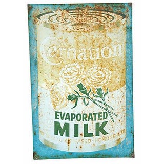Mid-Century Metal Carnation Milk Sign