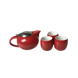 Sleek retro red tea set - includes a tea pot with built in infused and three cups.