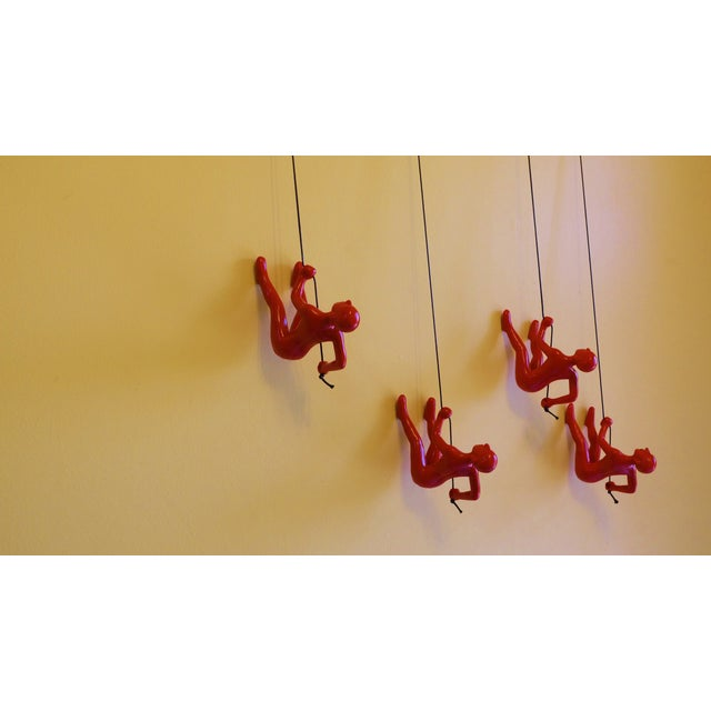 Image of Red Climbing Man Wall Art - Set of 4