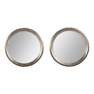 A pair of vintage silver leaf circular frames enclosing a mirror glass found in France (23 1/4″dia.)