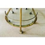 Image of Vintage Triple Tiered Brass Swivel Bar Cart