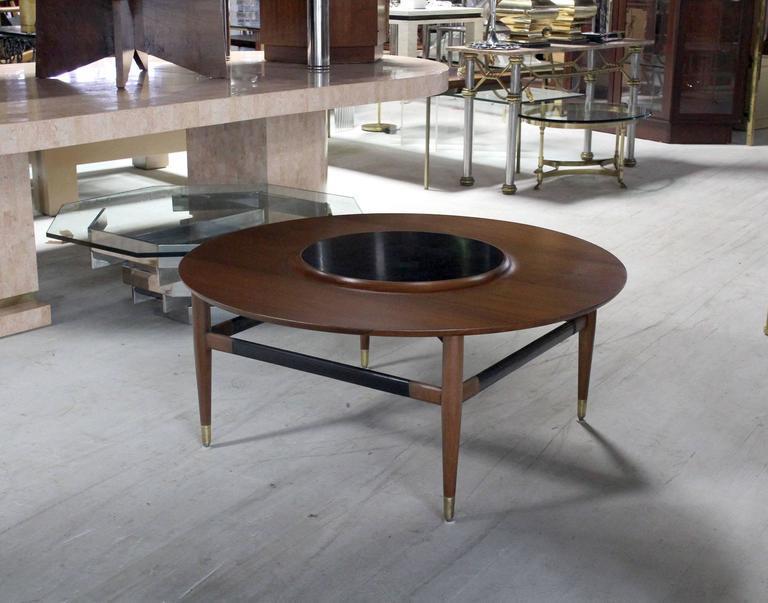 round walnut coffee table with raised black laminate lazy susan center image 8 of 8