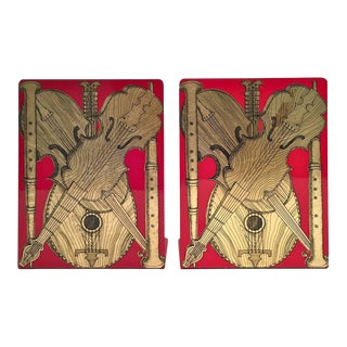 A Pair of Fornasetti Strumenti Musicali Music Metal Bookends, Atelier Fornasetti