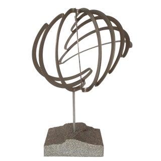Abstract Steel Ribbon Sphere Sculpture on Granite Base