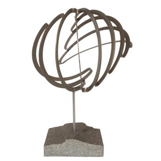 Abstract Steel Ribbon Sphere Sculpture on Granite Base