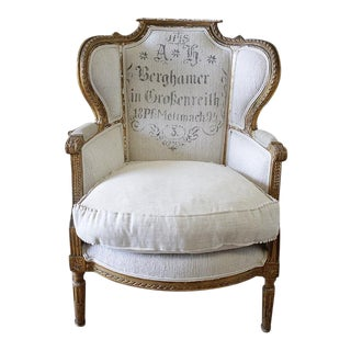 Antique French Louis XVI Style Wing Chair in Antique Grain Sack Upholstery