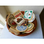 Image of Primitive Wood Bowl Full of Vintage Beer Coasters