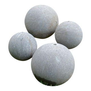 Four Carved Grey Marble Spheres