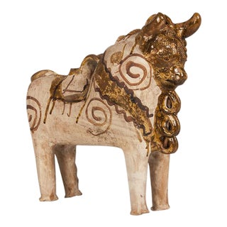 A large Vaullaris pottery bull in the style of Picasso with hand applied decoration from France c. 1930