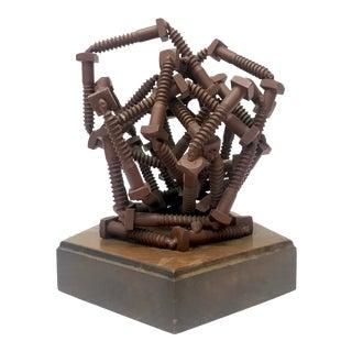 Bolt Sculpture on Wood Base