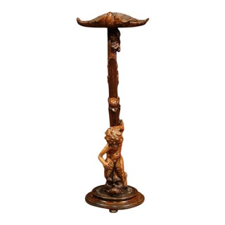 19th Century Italian Carved Walnut Selette With Seated Cherub