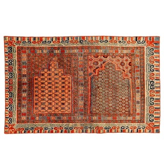 Rare and Early Khotan Rug with Two Niches