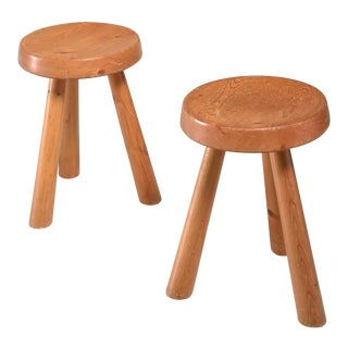 Charlotte Perriand pair of tripod pine stools from Les Arcs, France, 1960s