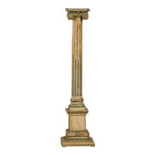 A fantastic neoclassical carved wooden candle stand with the original painted finish from Italy c.1890.
