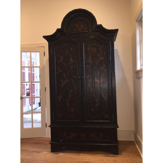 Image of Wooden Floral Decorated Armoire With Custom Trim