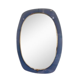 A Blue Glass Framed Wall Mirror in the style of Fontana Arte