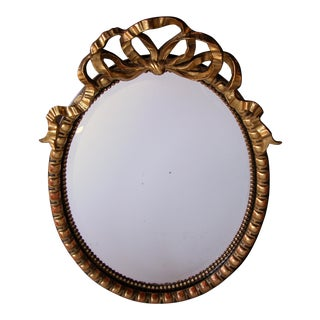 Large-Scaled Napoleon III Ebonized and Giltwood Oval Mirror
