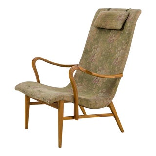 Carl-Axel Acking Lounge Chair with Aged Floral Upholstery, Sweden, 1940s