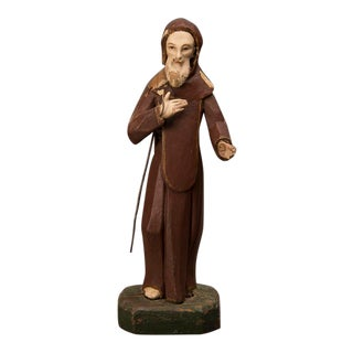 A carved and painted wooden statue of St. Francis of Assisi from 19th century Spain