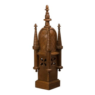 An elaborate small scale model of a medieval tower with four turrets carved of solid wood from France c. 1870