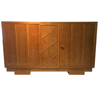 UNUSUAL SIDEBOARD OR CABINET IN CERUSED OAK ATTRIBUTED TO JACQUES ADNET