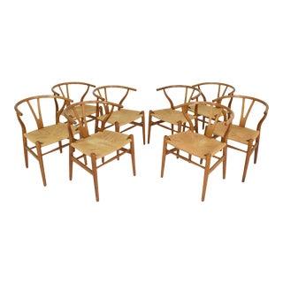"Set of 8 Hans Wegner ""Wishbone"" Chairs in Oak"