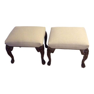 Heavily Carved Upholstered Ottomans - A Pair