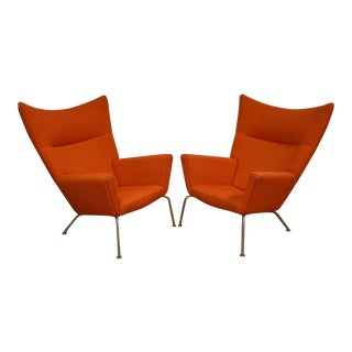 Hans J. Wegner CH445 Orange Lounge Chairs - a Pair