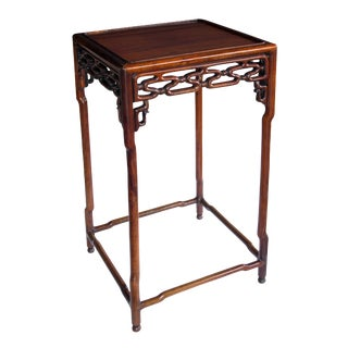 A richly patinated Chinese hongmu wood square side table with stylized openwork cloud-scroll apron and spandrels