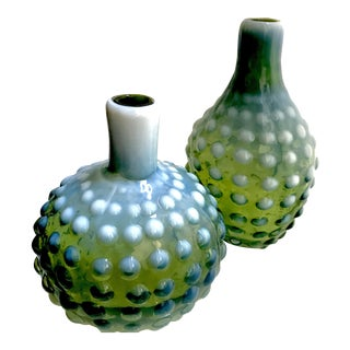 A Set of 2 Green With White Milk Glass Hobnail Vases Short and Tall